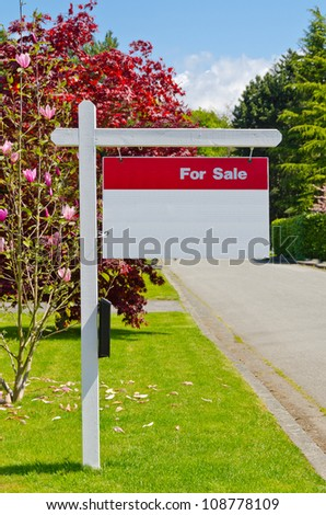 House For Sale Real Estate Sign - stock photo