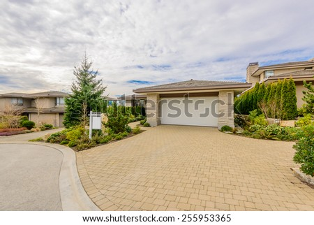 House For Sale. Real Estate Sign in Front of a House. Sold. - stock photo
