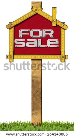 House For Sale Sign - Wooden Meter. Yellow wooden meter ruler in the shape of house with text for sale. For sale real estate sign isolated on white background with grass