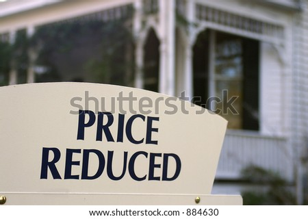 "House for sale with ""Price reduced"" sign - stock photo"