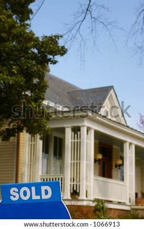 House for sale with sold sign - stock photo