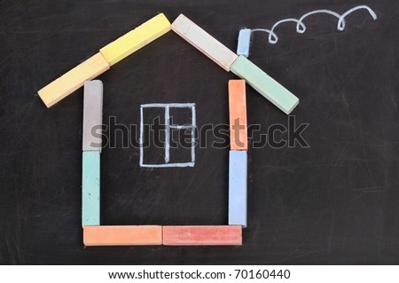 House from a chalk on a black board - stock photo