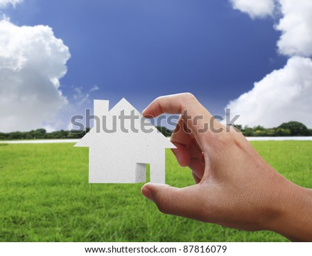 house from a paper in a hand