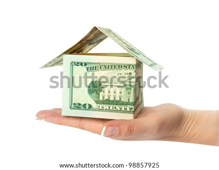 house from dollars bills in hand isolated on white - stock photo