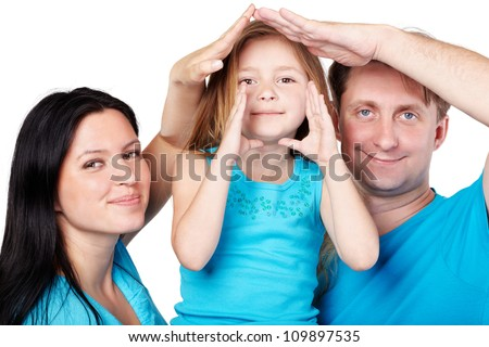 House from hands of family - stock photo
