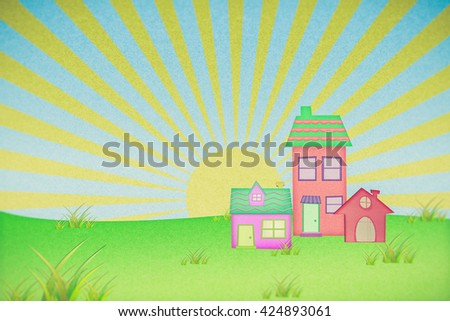 house from recycle paper with grass field and sun set background - stock photo