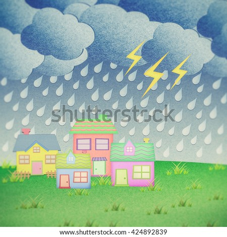 house from recycle paper with grass field in rainy time - stock photo