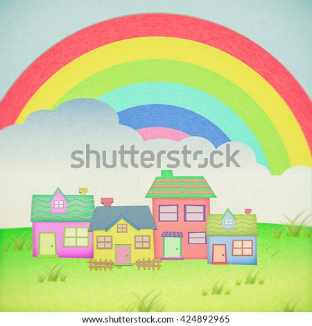 house from recycle paper with grass field rainbow background - stock photo