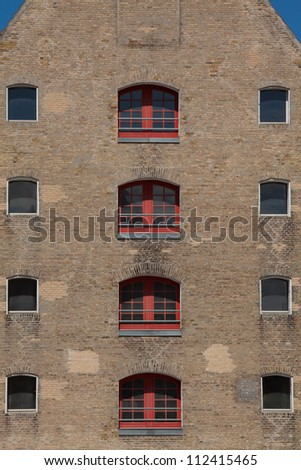 House front of a modernized warehouse - stock photo