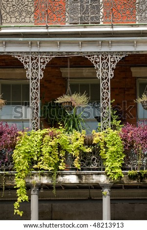 House gallery with exquisite ironwork in French Quarter, New Orleans - stock photo
