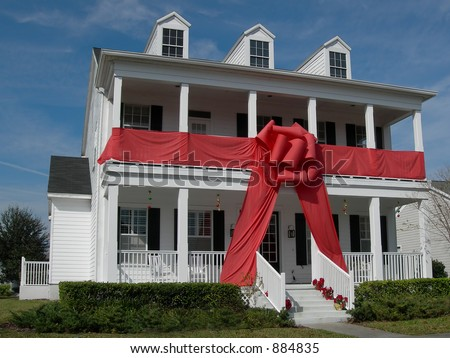 house gift-wrapped with giant red bow - stock photo