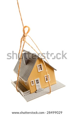 House Hanging by a String Isolated on a White Background. - stock photo