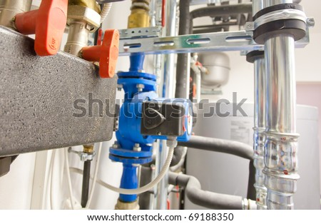 house heating system with tubes, pipes, valves close up - stock photo