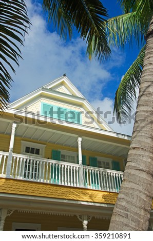House, home, Key West architecture, porch, veranda, windows, palms, Keys, Cayo Hueso, Monroe County, Florida, Sunshine State, coast, Gulf of Mexico, Atlantic Ocean, United States of America, Usa - stock photo