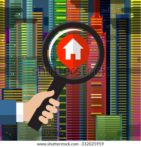 House hunting and searching for real estate homes for sale that need to be inspected by a home inspector concept as a magnifying glass inspecting a model single home building structure. - stock photo