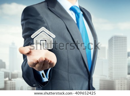 House icon in hand