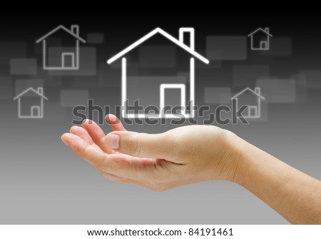 house icon in human hands - stock photo