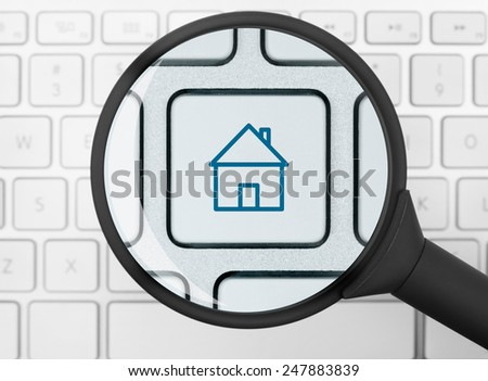 House icon under the magnifying glass - stock photo