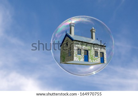 House in a bubble fly in the air. Concept photo of Real estate market bubble , booming, money,price, rent, grid, home, house, housing, industry and subprime mortgage crisis. (Copy Space). - stock photo