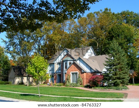 House in a subdivision and landscape in beautiful autumn colors - stock photo