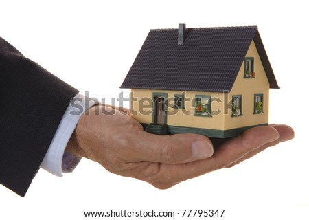 house in business hand - stock photo