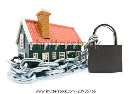 House in chains locked with padlock on white background - stock photo