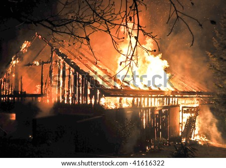 House in fire at night - stock photo