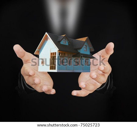 House in hand - stock photo