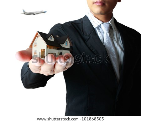 house in human a hands isolated on white background - stock photo
