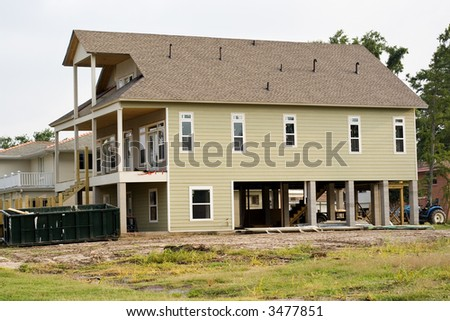 house in Lakeview area of New Orleans where homes are being raised to avoid possible flood waters from future hurricanes - many insurance companies are requiring this construction modification - stock photo
