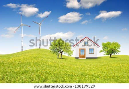 house in spring landscape with wind turbines - stock photo