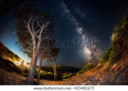 House in the countryside at night under the milky way - stock photo