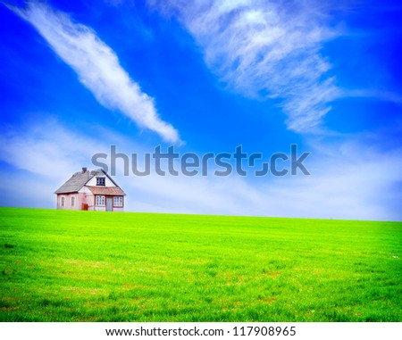 house in the field - stock photo