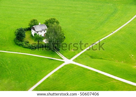 House in the green field of Saltzburg (view from Hohensaltzburg fortress) - stock photo