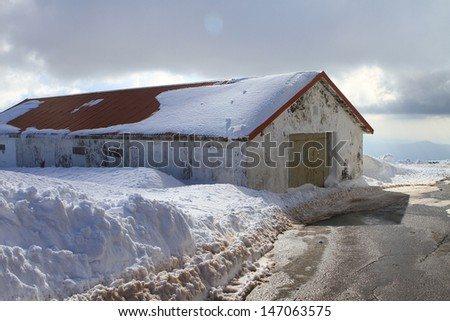 house in the snow mountain - stock photo