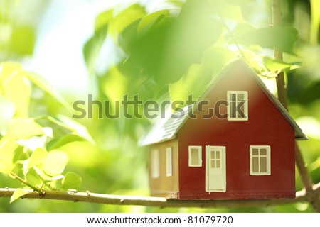 House in the trees - stock photo