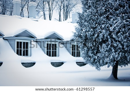 House in winter - stock photo