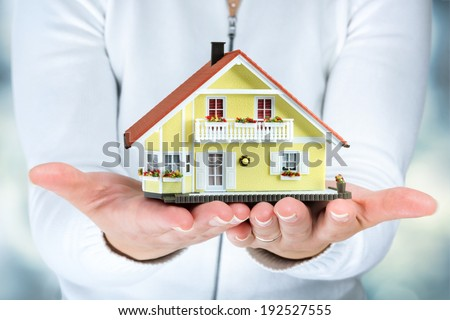 house in woman hands - real estate concept  - stock photo
