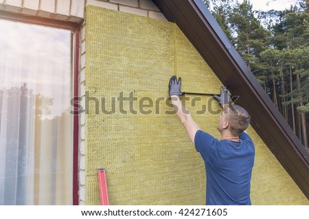 house insulation - insulating house facade with mineral rock wool - stock photo
