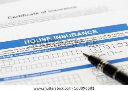 House insurance application with pen