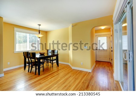 House interior. Entrance hallway and dining area with black table and chairs