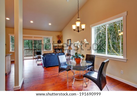 House interior. Open floor plan of living room with dining area.