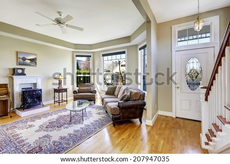 House interior. View of living room with fireplace and entrance hall