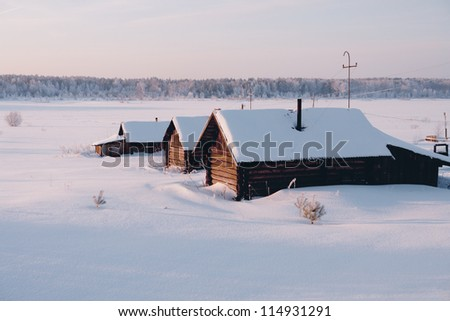 House is half covered with snow - stock photo