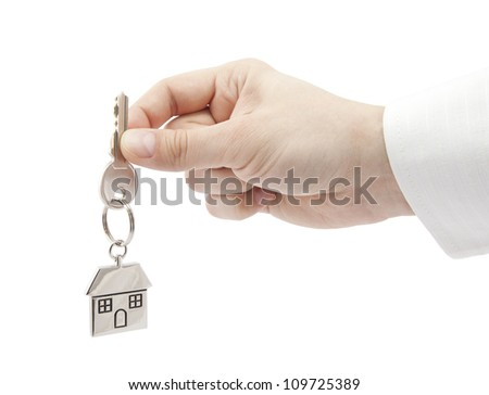 House key in hand with clipping path - stock photo