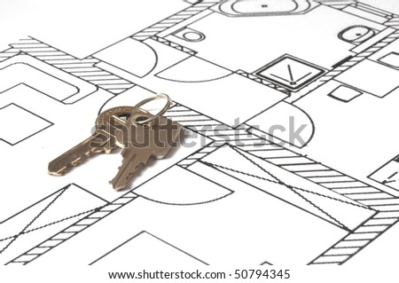 house key on a blueprint - relocate concept - stock photo