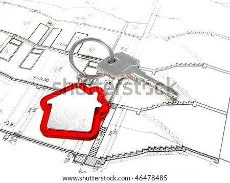 House key on architectural floor plans - stock photo