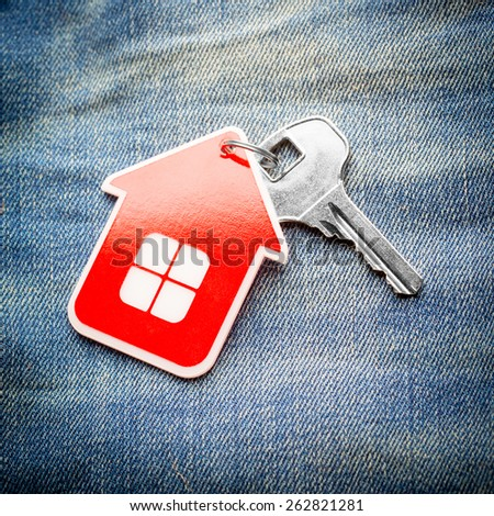 House key on jeans background, close-up - stock photo