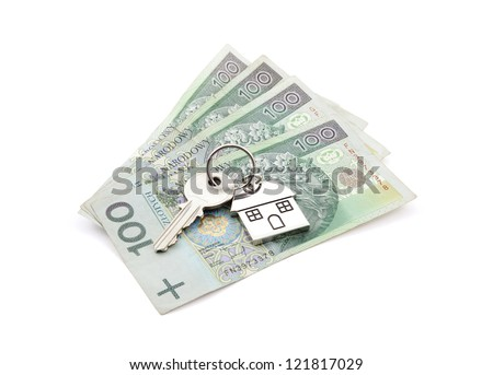 House key on pile of polish banknotes with clipping path - stock photo
