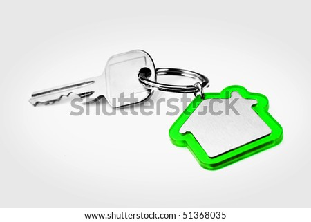 House key with a blank green key ring, fob for your logo or graphic - stock photo